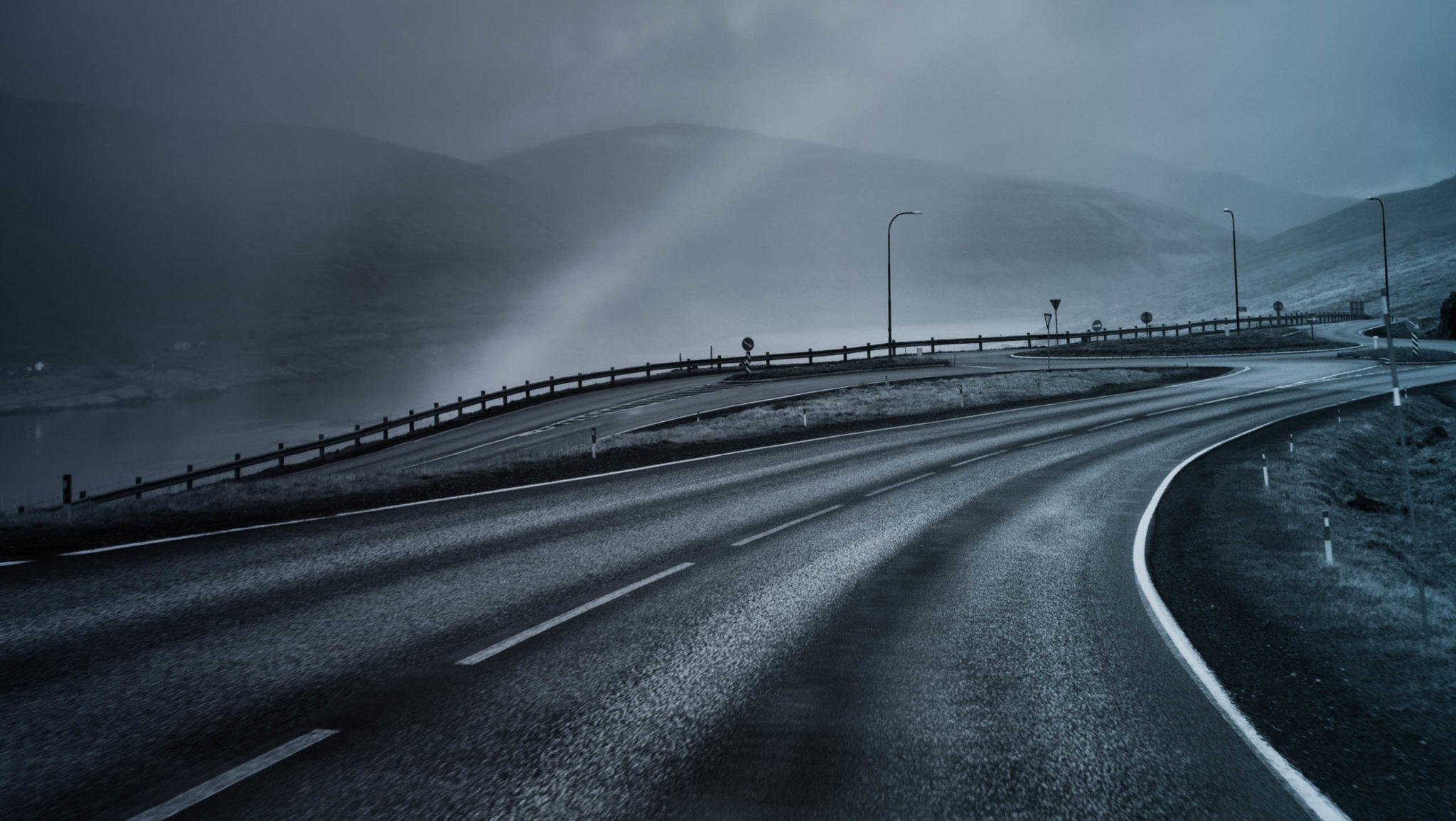 empty highway with misty hills
