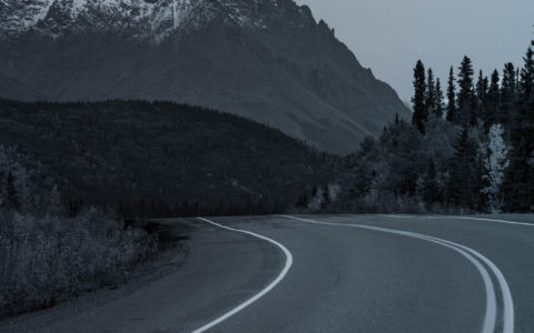 empty highway with mountain